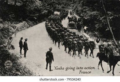 Yanks Going into Action France - Early 1900 postcard depicting Yankee soldiers going into action in France during WWI.