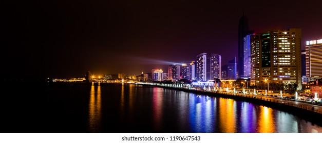 Yantai, China - view of the coastline in the night