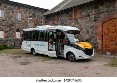 "Yantarny, Kaliningrad Region / Russian Federation - July 11, 2017: Bus FOX-2250 in the courtyard of ""Amber Castle"""