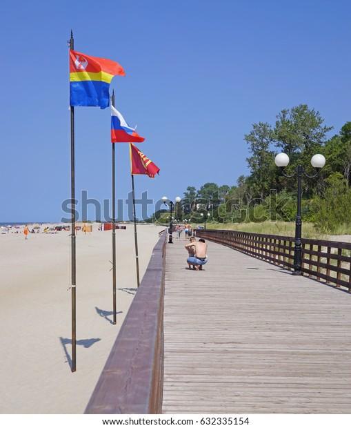 YANTARNY VILLAGE, RUSSIA - AUGUST 6, 2015: Public beach on coast of Baltic Sea. Widest in Kaliningrad region sandy beach first in Russia to receive Blue Flag