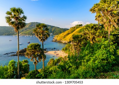 Yanui Beach is a paradise cove located between Nai Harn Beach and Promthep Cape in Phuket, Thailand. On a sunny summer day at sunset.