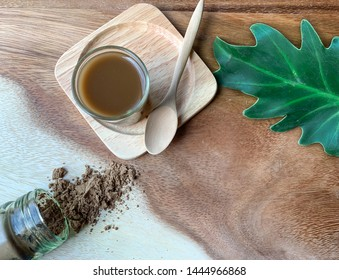 Yaom,Balsam,Cordial or Aromatic medicine is a traditional Thai traditional medicine on wood background and liquid drug. It the main components of aromatherapy drugs derived from many fragrant herbs