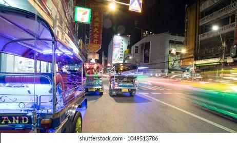 Yaowarat, Bangkok, Thailand December 4, 2017: Attractive light at night in Yaowarat. Tuk Tuk decorated with neon light. Waiting for passengers In the Yaowarat area
