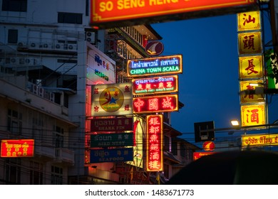 Yaowarat, Bangkok / Thailand - July 2019 : Gold shops name boards or signs are turn-on light in the evening. This is signature classic view of Yaowarat, the famous China town in Bangkok.