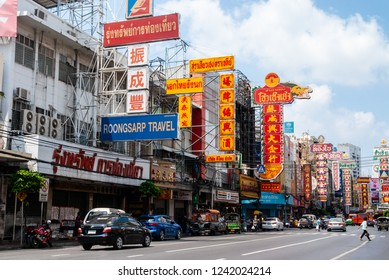 Yaowarat, Bangkok, Thailand - March 4, 2018: The street view of Yaowarat or Thailand China town with people crossing street.