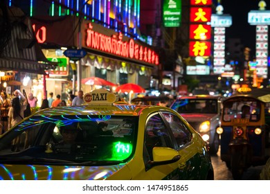 Yaowarat road, Bangkok / Thailand - July 2019 : Taxi service is parking and waiting for passenger at Yaowarat famous China town of Thailand. Close up at Taxi light sign.