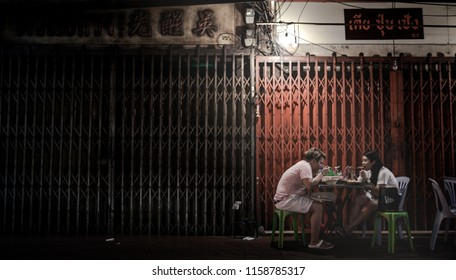 Yaowarat road,Bangkok, August 17th 2018 : Tourist eating on the street food market in Yaowarat road, the main street of Chinatown in Bangkok. Chinatown is one of the famous landmark in Bangkok.