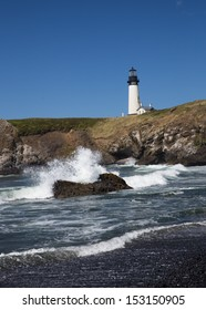 Yaquina Head Black and White Lighthouse with Crashing Wave From Black Rock Beach