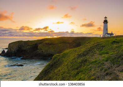 Yaquina Head lighthouse by the Oregon Coast on a beautiful sunset