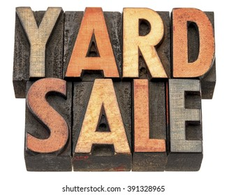 yard sale banner  - isolated text in vintage letterpress wood type printing block stained by color inks