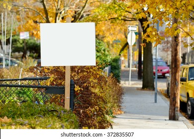 Yard sign in the fall