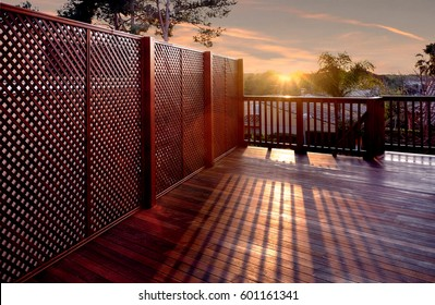 Yard with wooden floors and wooden fence with the sunset view