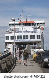 YARMOUTH HARBOUR ISLE OF WIGHT - JULY 2016 - A roll on roll off ferry berthed on the waterfront as foot passengers walk aboard
