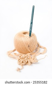 Yarn ball and crochet hook, isolated on white