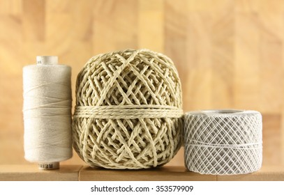 yarn in front of wooden background