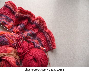 Yarn for knitting. Red woolen threads.