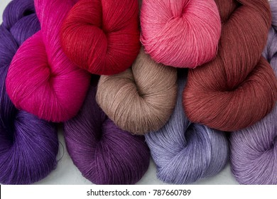 Yarn skein, colorful thread in skeins, Red pink purple yarn collection