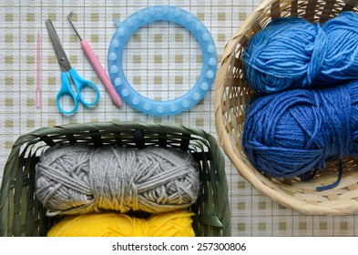Yarns in baskets and knitting tools
