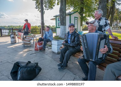 Yaroslavkaya Oblast, Russia - august 29, 2019: Group of old people playing the accordion and singing in a central park of the city of Yaroslavl