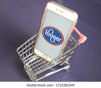 Yaroslavl, Russia - 26 April 2020: Smartphone an shopping trolley with Kroger logo.