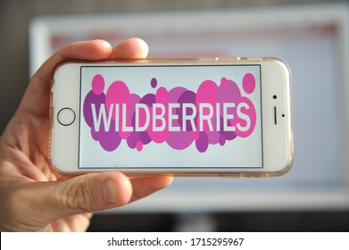 Yaroslavl, Russia - 26 April 2020: Human hand holding smartphone with Wildberries logo. Wildberries is the largest online store anв marketplace in Russia.