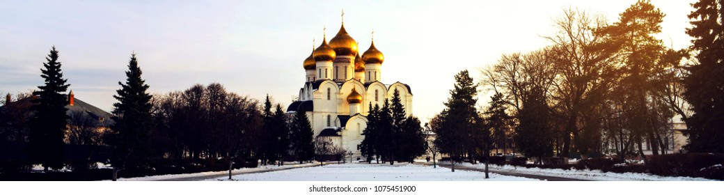 Yaroslavl, Russia. The Assumption Cathedral in Yaroslavl, Russia in winter - Golden domes and Crosses, snow covered park in the evening. Famous touristic place at Golden Ring tour in Russia