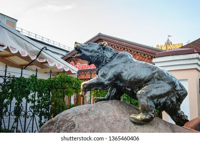 YAROSLAVL, RUSSIA - AUGUST 4, 2018: The figure of a large bronze bear on a large granite stone - a symbol of the city of Yaroslavl and Russia