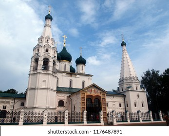Yaroslavl (Russia), view on the church of St Elijah the Prophet (Ilyi Proroka). Blue sky with white clouds. White stone church with green cupolas and golden crosses.