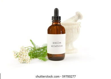 Yarrow herbal tincture, Achillea millefolium. The label was made for the photo shoot. Achillea millefolium is the Latin name of yarrow, not a brand name or a trademark.