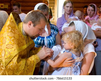Yartsevo, Russia - July 17, 2011: The priest holds the rite of anointing the child after baptism