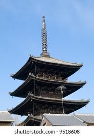 Yasaka pagoda tower, Hokanji Temple over the rooftops of houses near Kiyomizu Temple in Kyoto Japan.