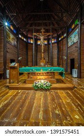 YASOTHON, THAILAND - APRIL 1, 2019 : The largest wooden Christian church in Thailand and up to 100 years old, Ban Song Yaeng Church, Yasothon Province, built in Thai style.