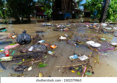 Yasothorn, Thailand - September 12, 2019: Flood and plastic pollution floating on water flood cuase of communicable disease