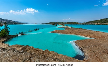 Yatagan blue lake, also known as Kuldagi Lake, has such a magnificent color, the sight is enchanted. However, there is such a truth behind this eye-catching turquoise color that it poses a serious  - Shutterstock ID 1973875070