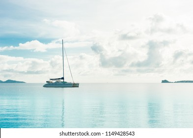 A yatch in the clam sea with blue sky background