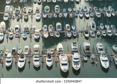 Yatch harbor marina pier and boat dock yatchs and vessels awaiting the open sea. Aerial drone view looking straight down above T-Head.