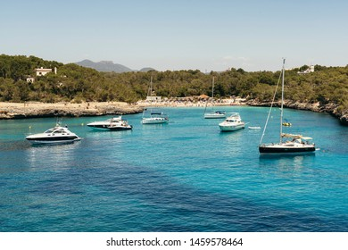 Yatchs in turquoise water in Cala Mondrago, Mondrago Natural Park, Majorca.
