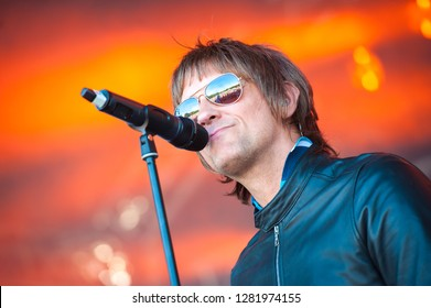 YATELEY, UK - JUNE 24: Tribute artist Paul Higginson performing as Oasis frontman Liam Gallagher at the Gig On The Green Festival in Yateley, UK on June 24, 2018