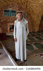 Yatta, Palestine, June 28, 2014: An imam is posing for a picture in an old mosque in Yatta, West Bank.