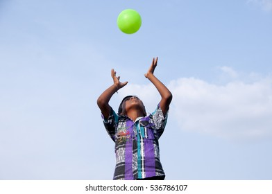 YAVATMAL, MAHARASHTRA, INDIA, 21 JUNE 2013 : Unidentified Happy Indian rural boy playing with ball at his village.