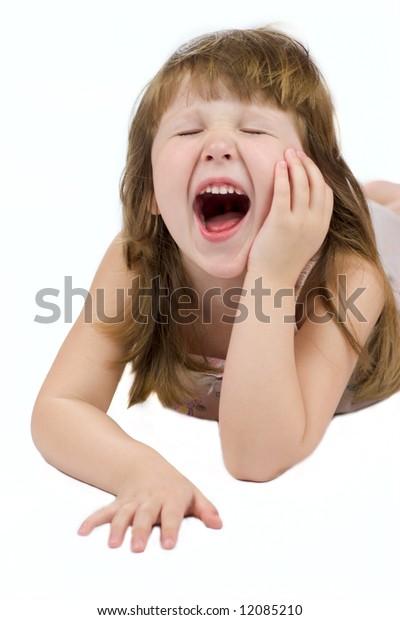 Yawning child with eyes closed isolated on white