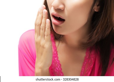 Yawning tired woman isolate on white background