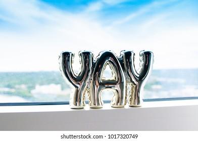"""Yay"" Decoration on a Window"