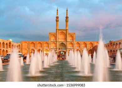 Yazd, Iran - 26 October, 2018: Fabulous view of the Amir Chakhmaq Complex and beautiful fountain in the historical city of Yazd at sunset. Unique Persian architecture of the ancient town.