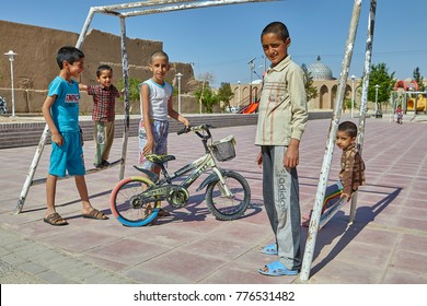 Yazd, Iran - April 21, 2017: Five Iranian boys of school age stand on a playground in the vicinity of the old city.