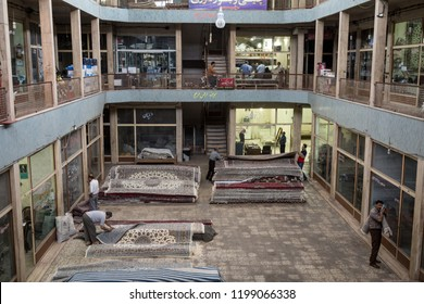 YAZD, IRAN - AUGUST 10, 2015: Carpets for sale in the rug district of the Kashan Bazaar. Carpets and Rugs are one of the symbols of Persian culture. Kashan is one of the main cities of central Iran