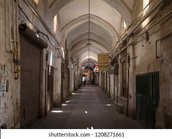 YAZD, IRAN - AUGUST 19, 2018: Street of the Yazd Khan bazar in the afternoon, empty and deserted, in a covered alley of the market. Symbol of Persian architecture, it's a major landmark of the city