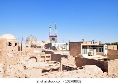 YAZD, IRAN - CIRCA AUGUST 2012: Jamah Mosque seen from the roofs of ancient buildings of Yazd circa August 2012. Yazd is one of the oldest cities in Iran.