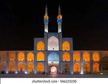 Yazd, Iran - December 17, 2015: Facade of illuminated Amir Chakhmaq mosque at night in Yazd, Iran.