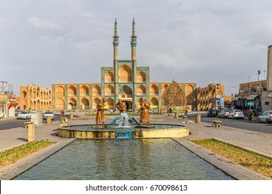 YAZD, IRAN - MAY 4, 2015: Fountain statues of three old travelers in front of famous Amir Chakhmagh Square in old city center.